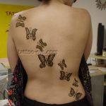 butterflies on back henna tattoo