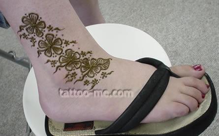 hibiscus flower ankle henna tattoo