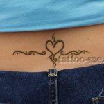 heart design lower back henna tattoo