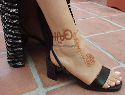 flower ankle henna tattoo