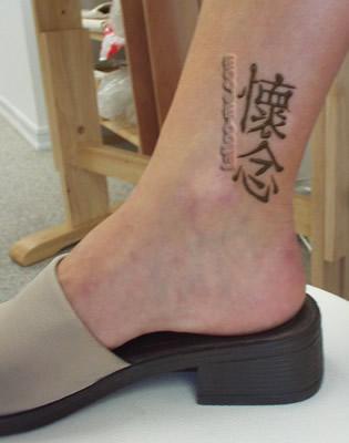 kanji ankle henna tattoo