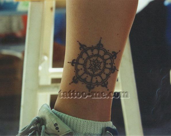 poinsettia flower ankle henna tattoo